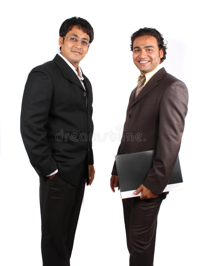 Young Indian Businessmen. A pair of young Indian businessmen in a happy mood after a meeting, isolated on white studio background stock photo