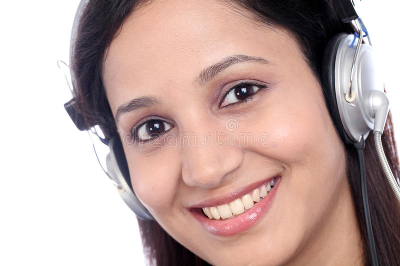 Young Indian call center girl. Happy young Indian call center girl against white background royalty free stock photo