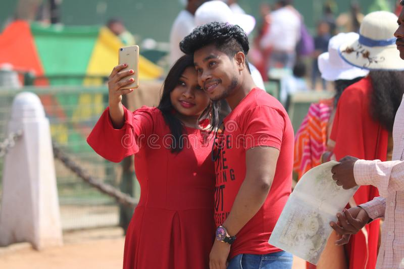 Young Indian couple taking selfie on streets of New Delhi, India royalty free stock photography
