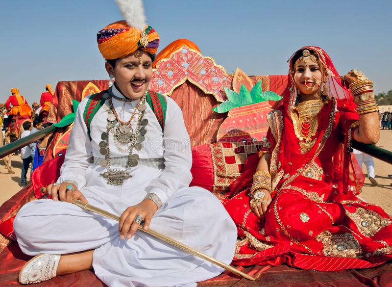 Young indian couple in traditional clothing happy to watching the Desert Festival royalty free stock photo