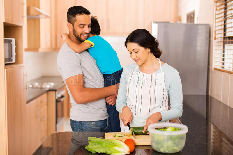 Young indian family cooking royalty free stock photos