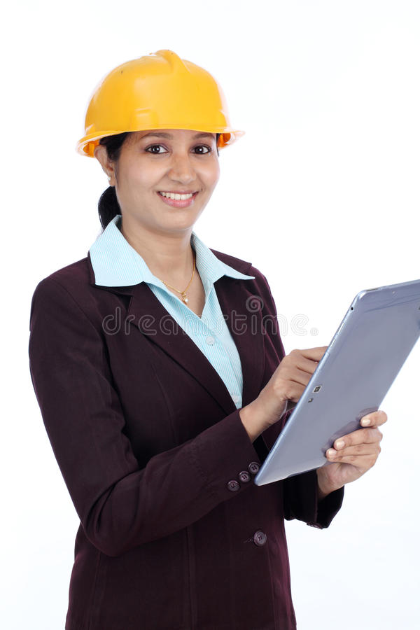 Young Indian female engineer with tablet stock image