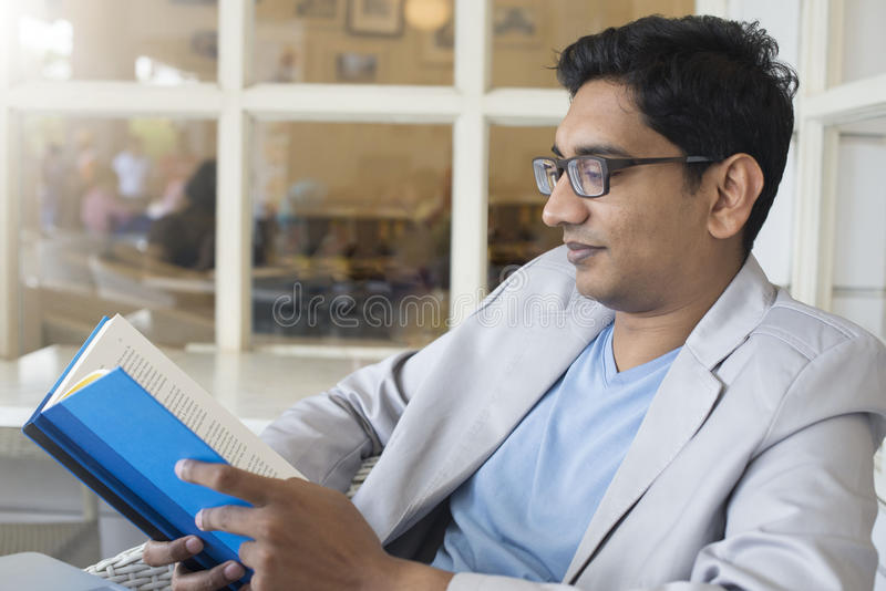 Young indian male reading stock photos