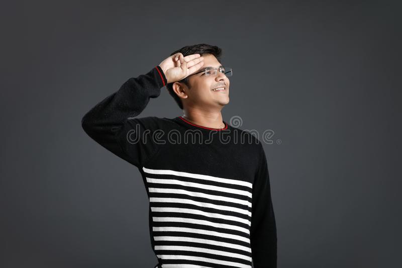 Young indian man salute stock image