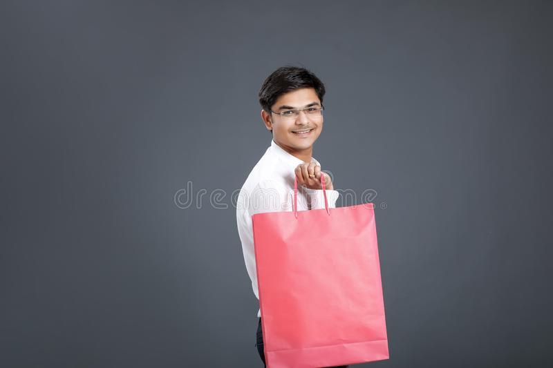 Young Indian man with shopping bags royalty free stock photo
