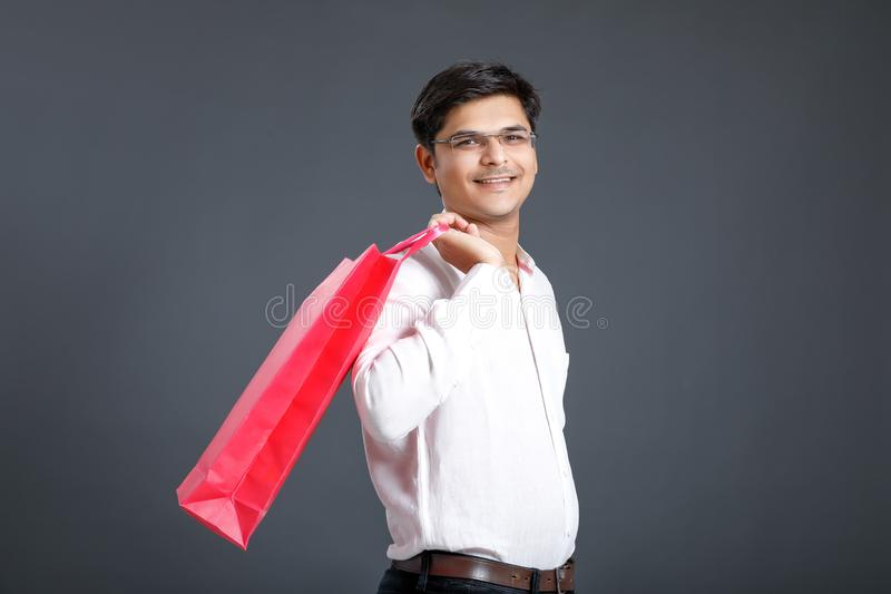 Young Indian man with shopping bags stock photos