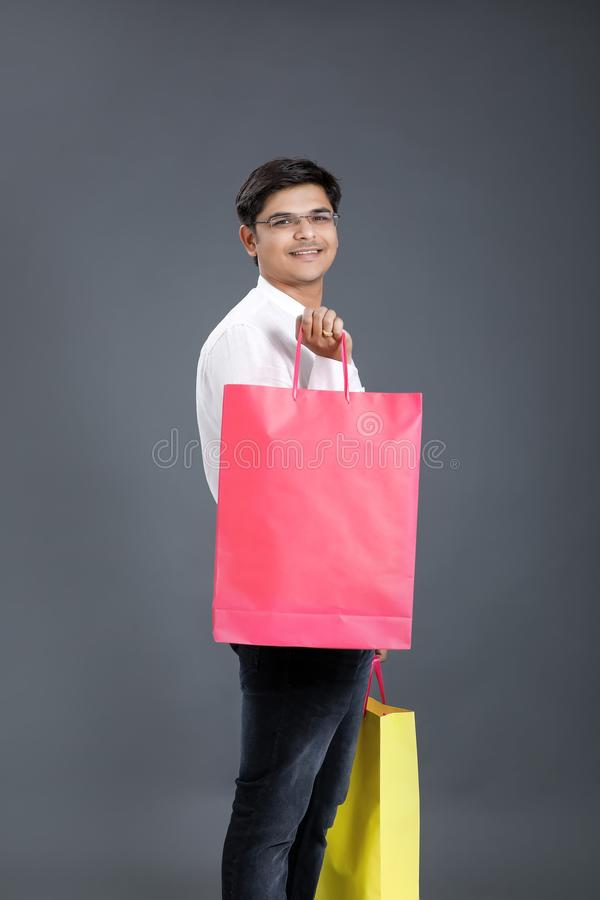 Young Indian man with shopping bags stock photography