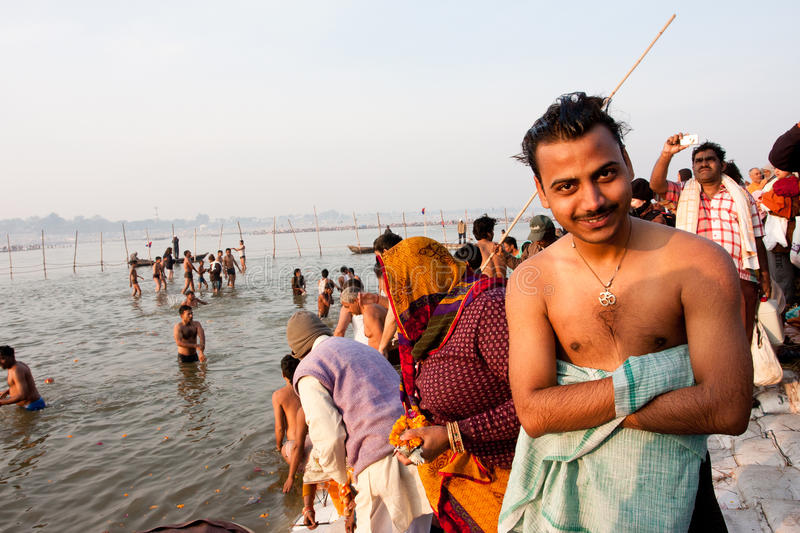 Young indian man smiling after bathe stock images