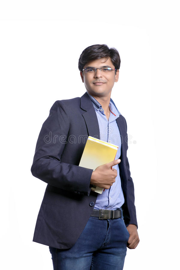 Young Indian on suit with book stock images
