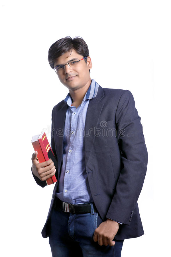 Young Indian on suit with book stock image