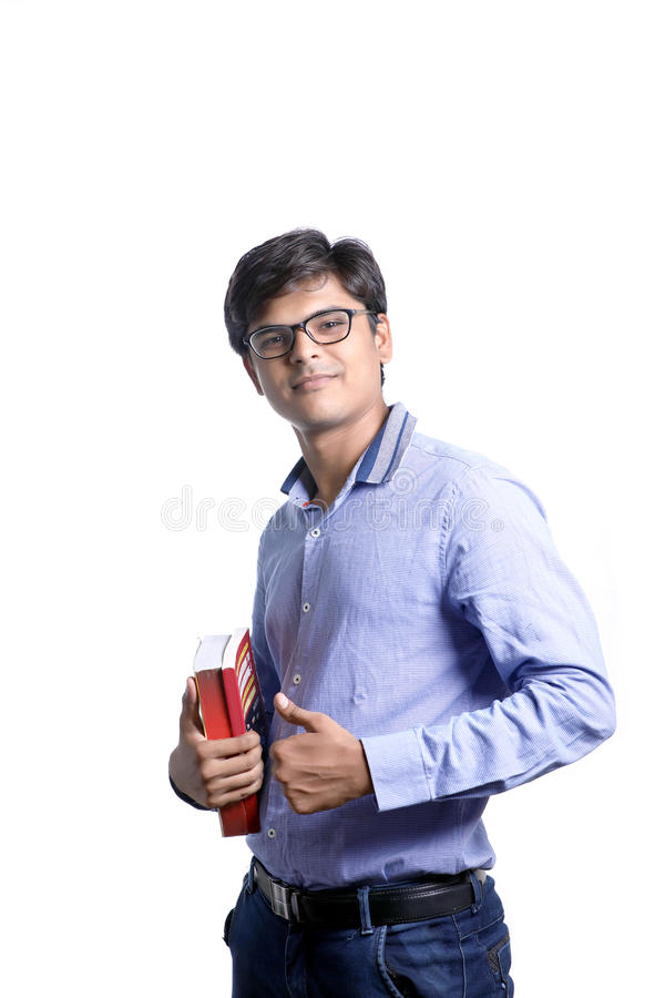 Young Indian on suit with book royalty free stock photography