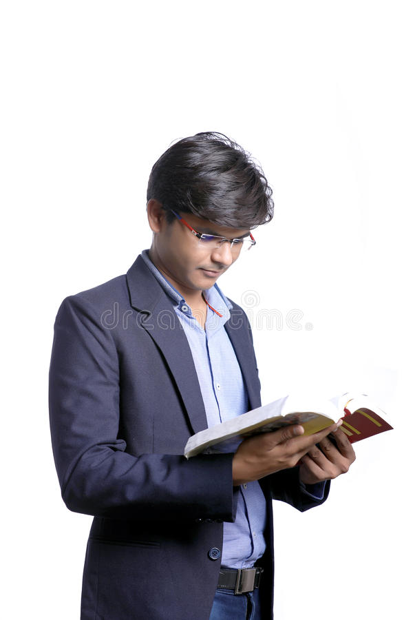 Young Indian on suit and reading book royalty free stock photography