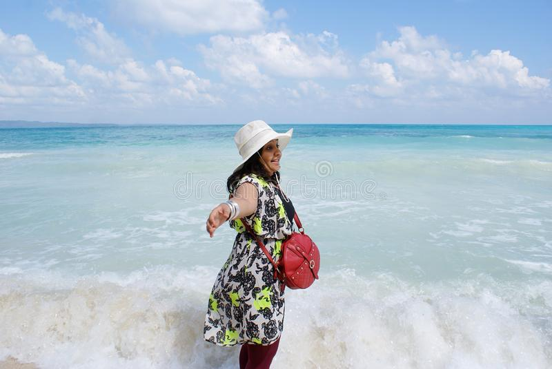 A young Indian woman enjoying in the seas of Radhanagar Beach, Havelock Island royalty free stock photo