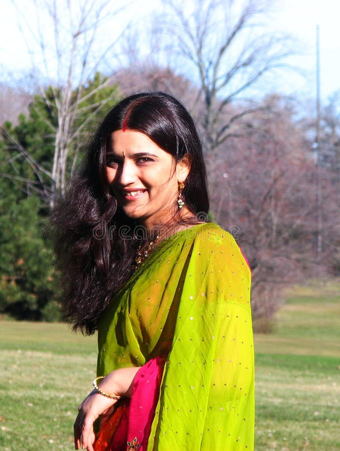 Download Young Indian woman smiling stock image. Image of casually - 20032929