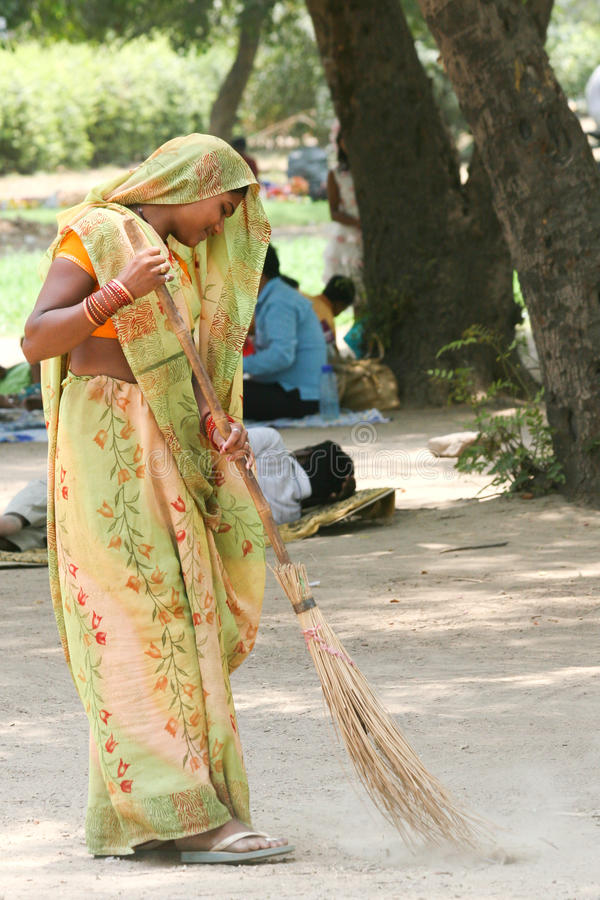Young indian women working. Young indian women in colorful traditional dresses sweeping in New Delhi, India on a Sunday morning. 27th June, 2010 royalty free stock photography