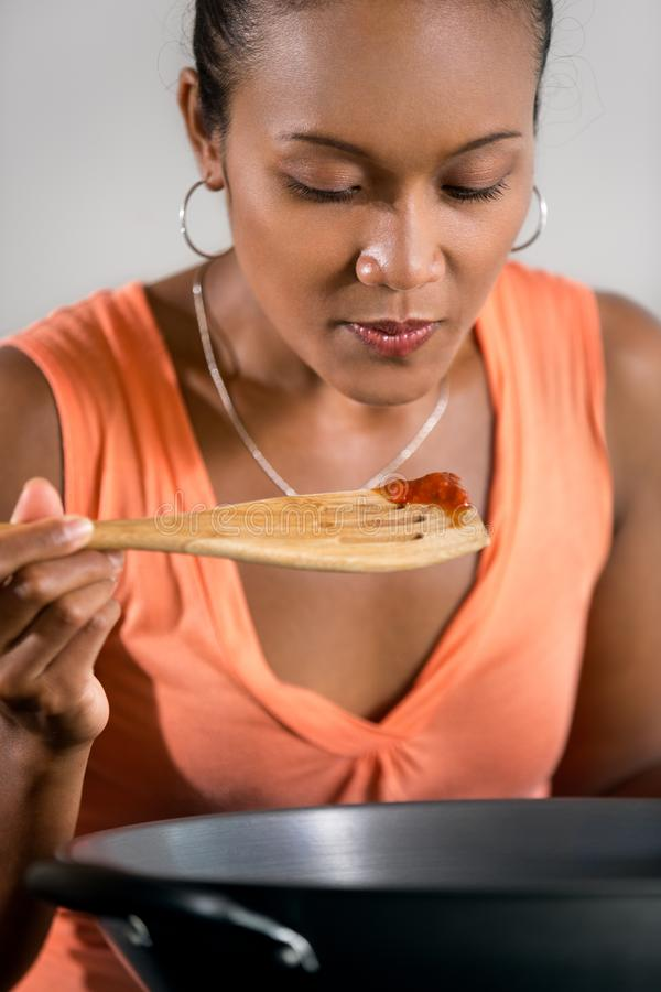 Young Indonesian woman testing the food royalty free stock image