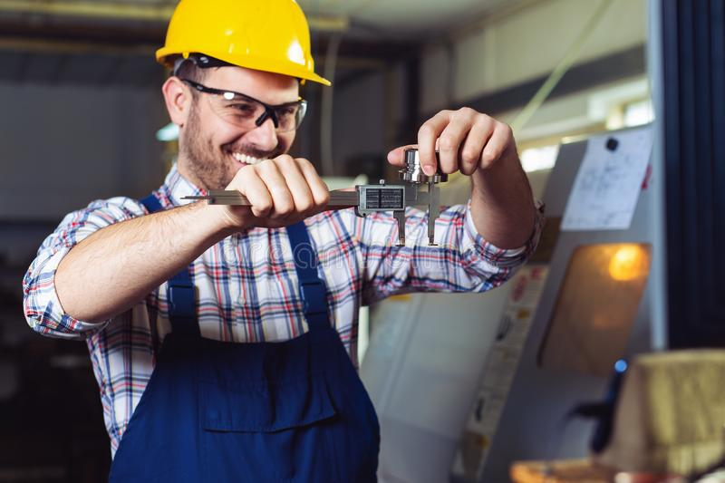 Industrial worker inspector measuring detail with Vernier Caliper stock images