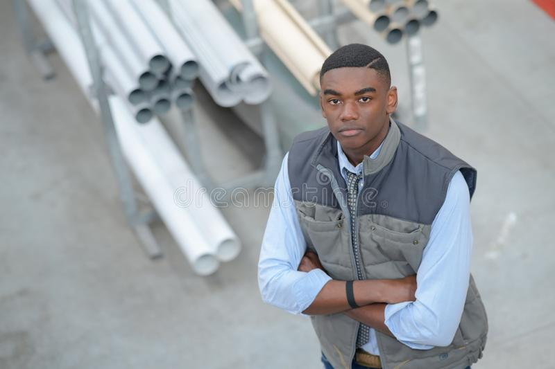 Young industrial worker outside factory royalty free stock images
