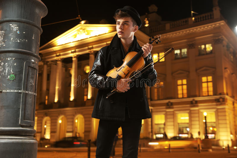 Young innocent musician with violin royalty free stock image