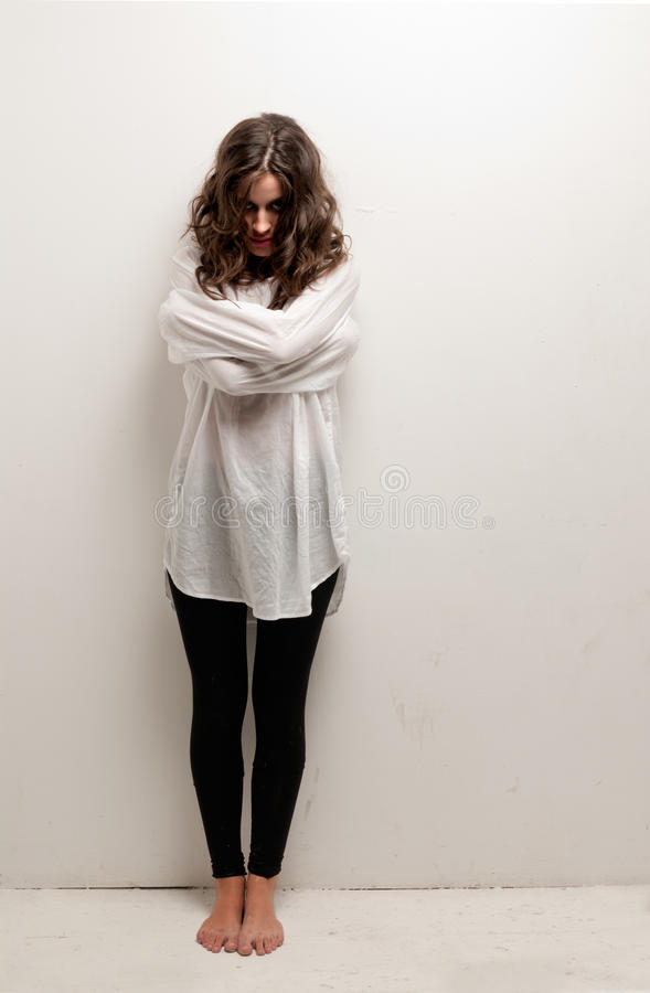 Young insane woman with straitjacket standing royalty free stock photo
