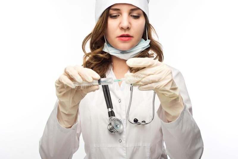Young girl nurse in glasses prepares syringe stock photography
