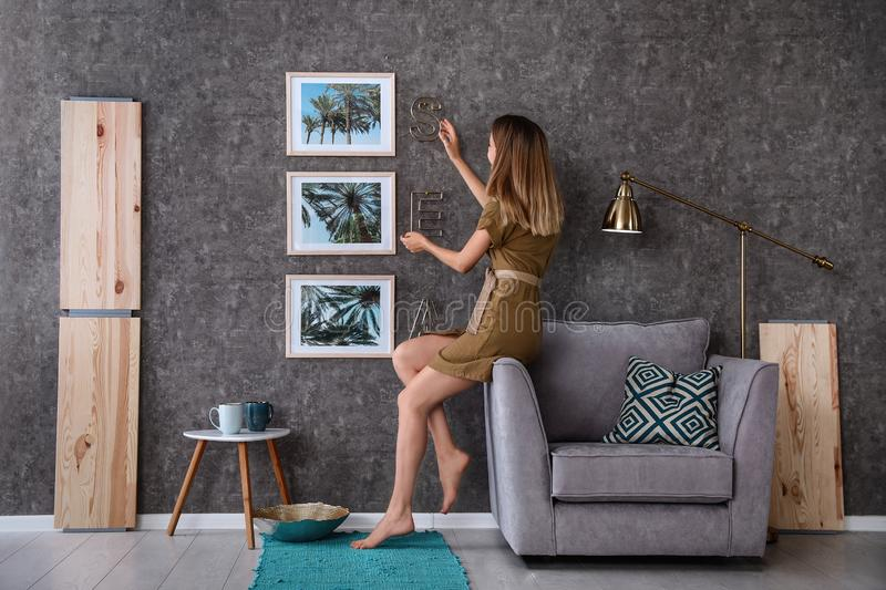 Young interior designer at work in room royalty free stock image
