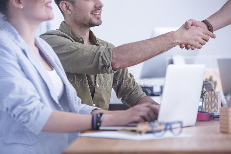 Handshake at the office royalty free stock image