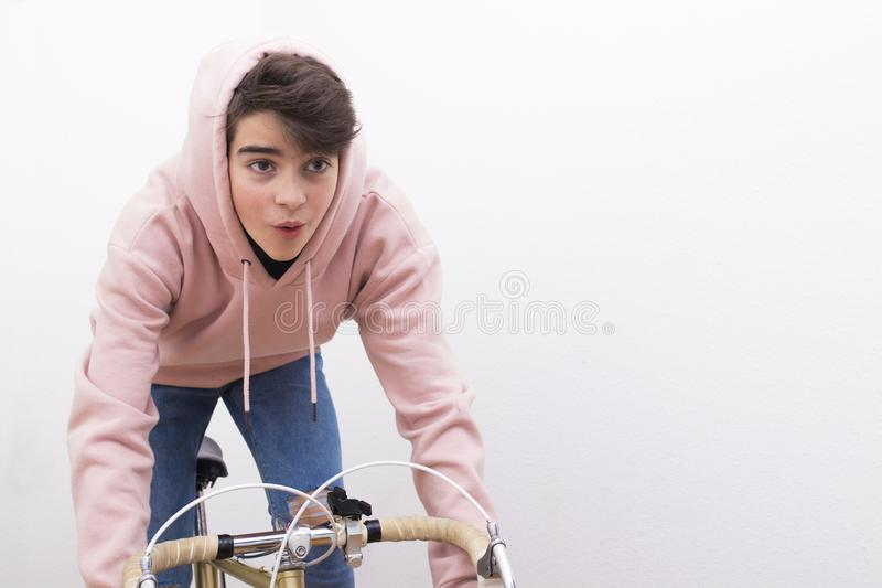 Young in isolated bike royalty free stock image