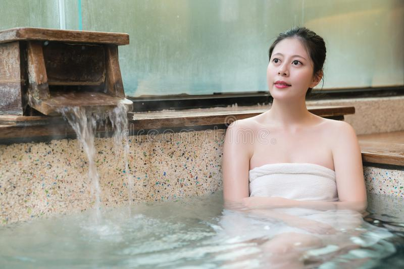 Young japan woman takes natural thermal waters stock photo