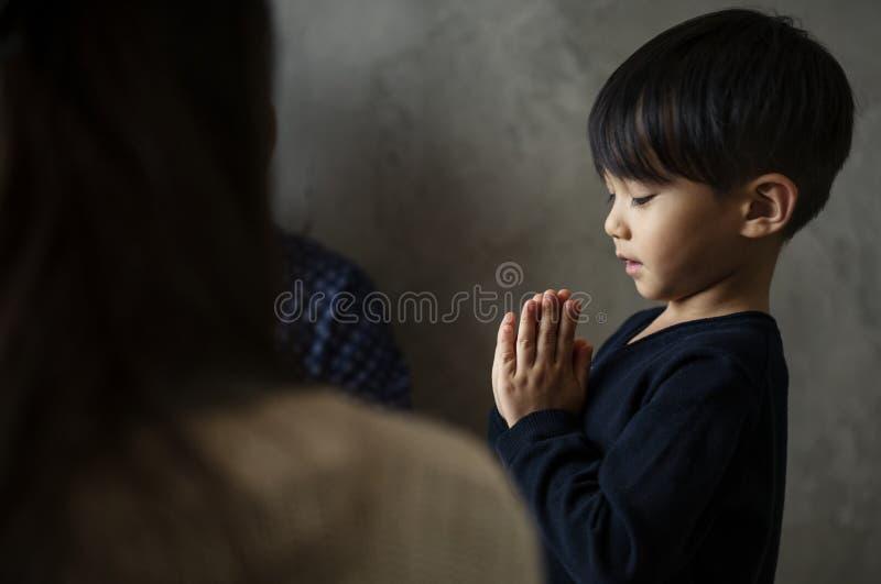 Japanese boy praying stock images