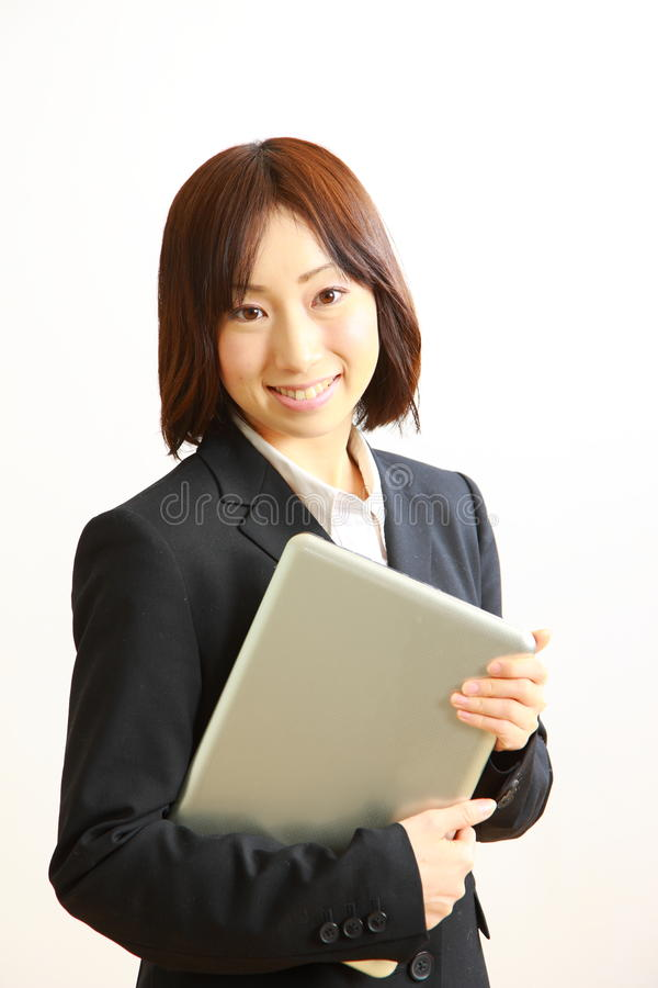 Young Japanese business woman with computer . Concept shot of young woman's lifestyle stock image