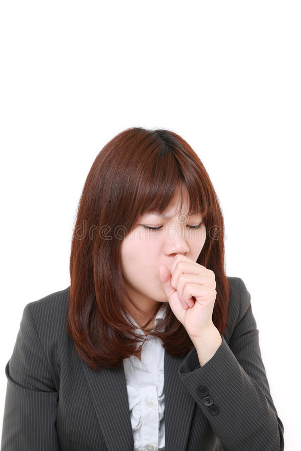 Young Japanese businesswoman coughing. Studio shot of young Japanese businesswoman on white background royalty free stock images