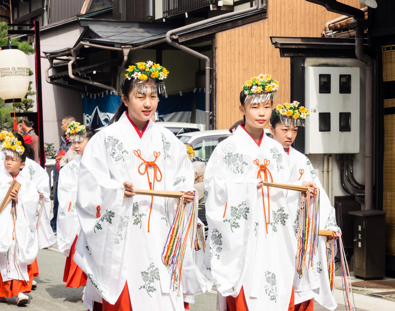 Young Japanese girls dressed and miko shinto pristesses stock photography