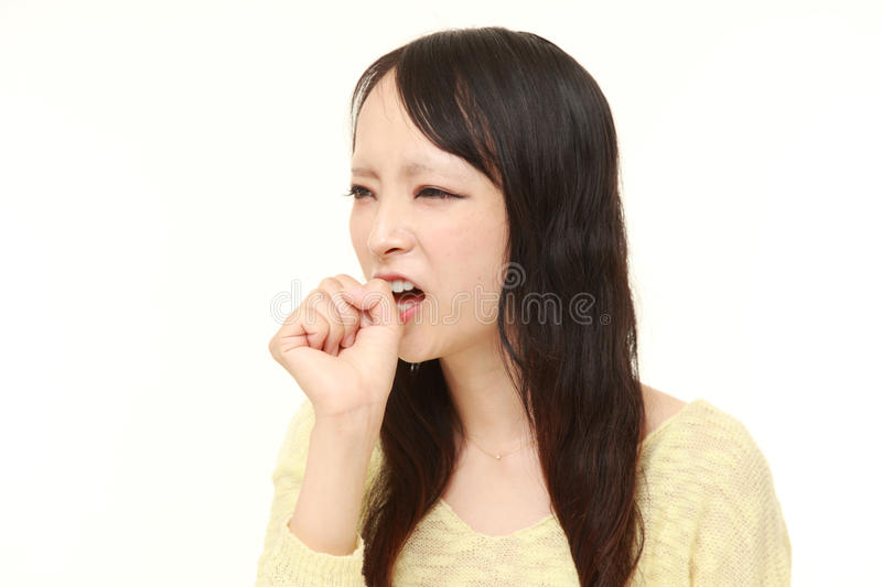 Young Japanese woman coughing . Studio shot of young Japanese woman's portrait on white background stock photos