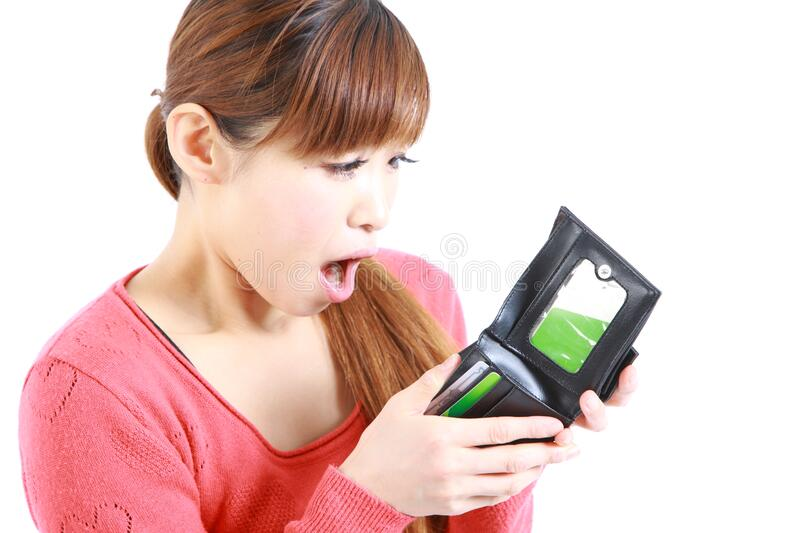 Young Japanese woman looking at her empty wallet. Concept shot of young womans life style stock image
