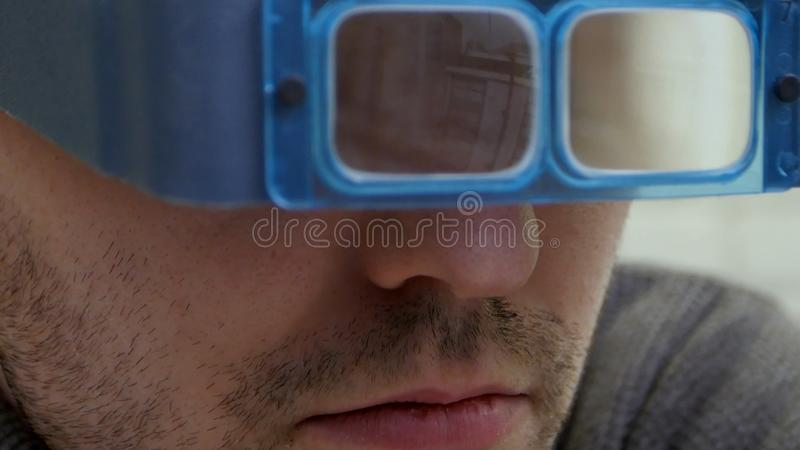 Young jeweler master checking the quality of gems through glasses stock photos