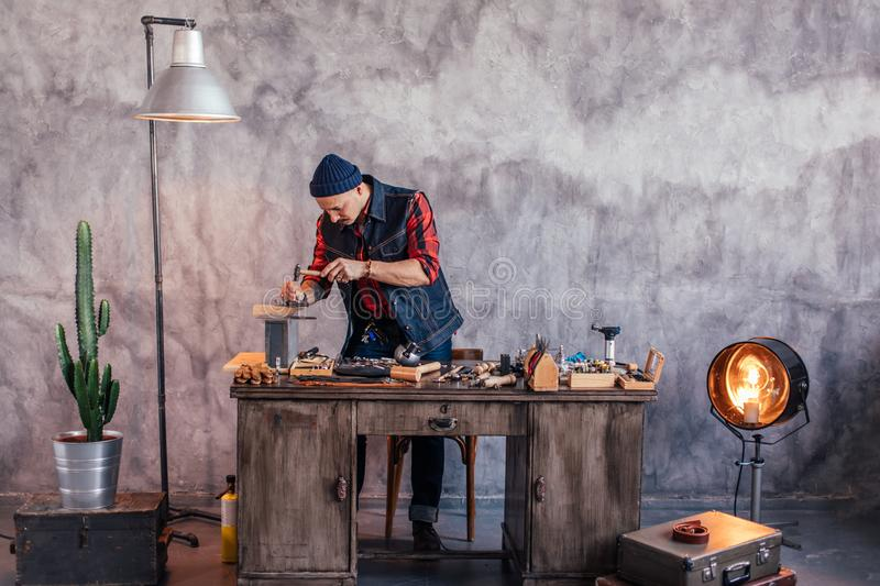 Young jeweler replacing stones in rings royalty free stock images