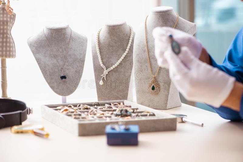 Young jeweler working in his workshop royalty free stock photos