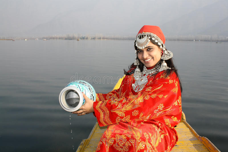 Young Kashmir Girl Collecting Water from Dal Lake
