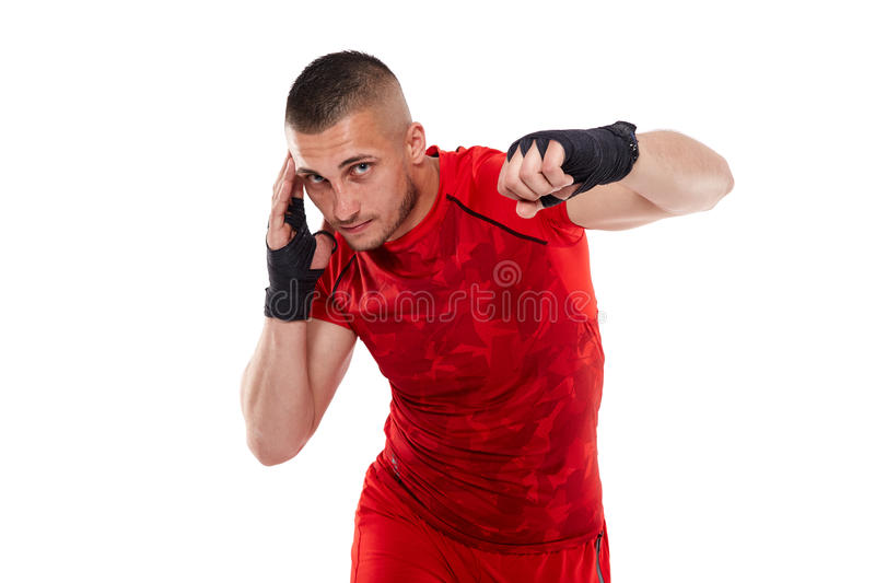 Young kickbox fighter on white stock photography