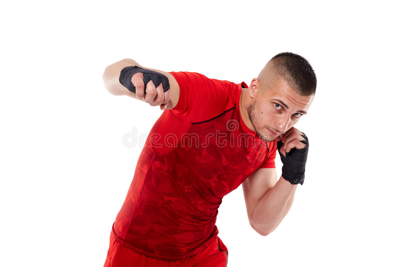 Young kickbox fighter on white stock photo