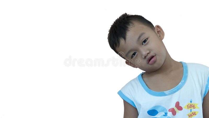 The young kid in front of a wall stock image