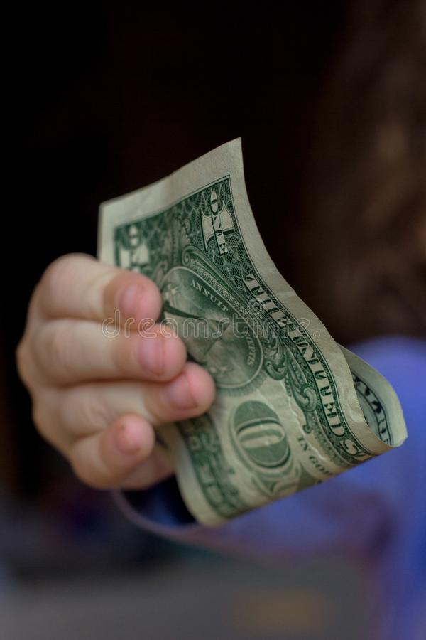 Young kid girl holding money in hands royalty free stock images