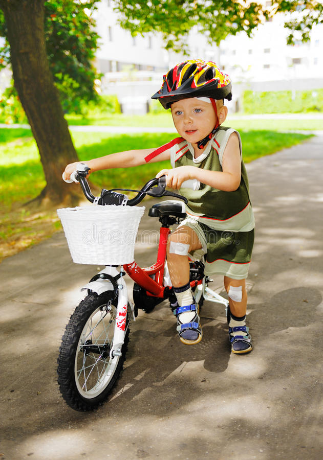 Young kid injured knees learning ride bicycle bike royalty free stock photography