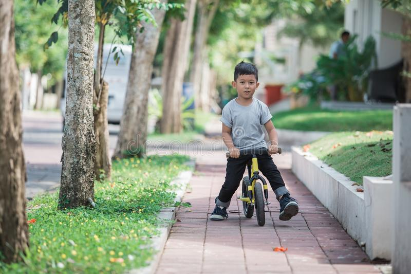 Ride a bike using push or balance bicycle royalty free stock photography