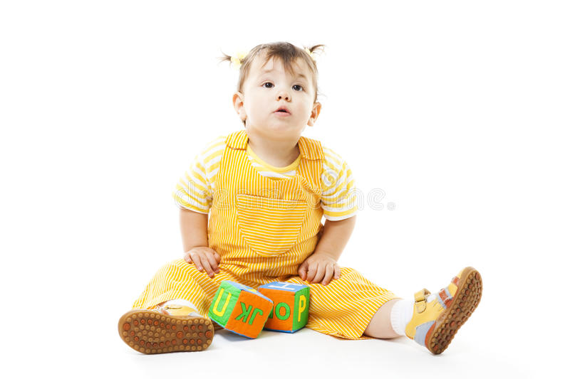 Young kid play with block with letters stock images