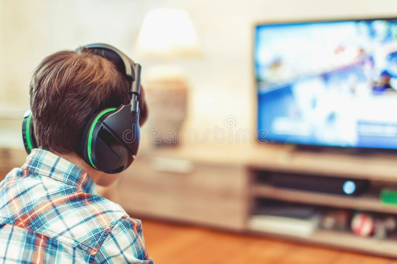 Young kid playing mass multiplayer game online royalty free stock image