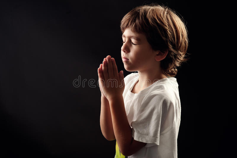 Download Young Kid In A Spiritual Peaceful Moment Praying Stock Image - Image of light, caucasian: 25712311