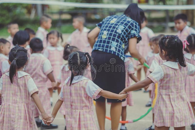 Young Kids exercise with hoola hoop. Young Kids exercise with hoola hoop in the morning stock image