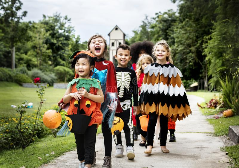Young kids trick or treating during Halloween stock photography